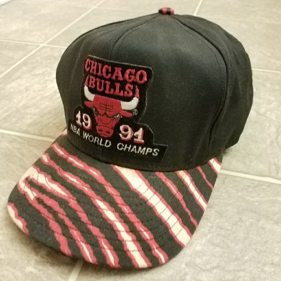 506bc94d705 NBA Chicago Bulls 1991 Championship Snapback Cap.  M 5aefae4900450f6cbdefc66f. Other Accessories ...